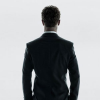 First high resolution theatrical poster for FIFTY SHADES OF GREY has its back the audience
